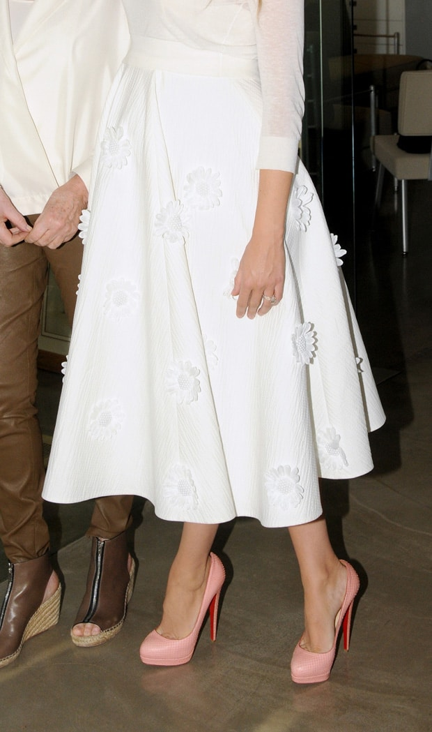 Blake Lively paired her full skirt with Christian Louboutin Alti pumps in pink