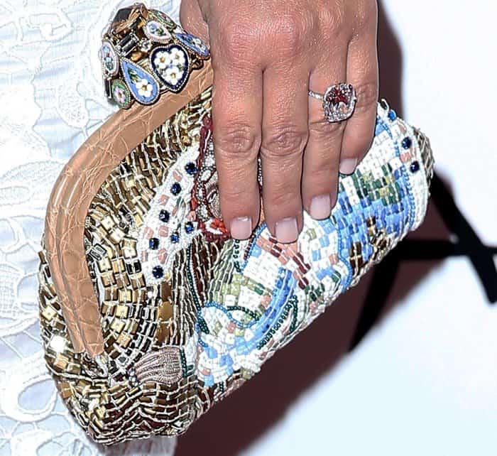 Kim Kardashian toting a bejeweled clutch
