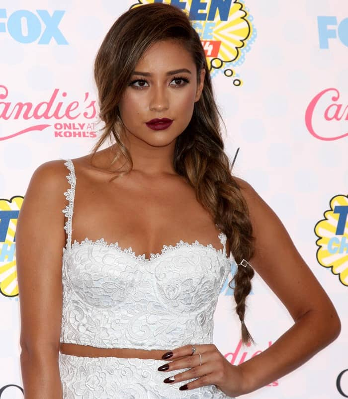 Shay Mitchell sported a white sheer-hem pencil skirt with a matching lace bustier from the Misha Collection Fall 2014 collection