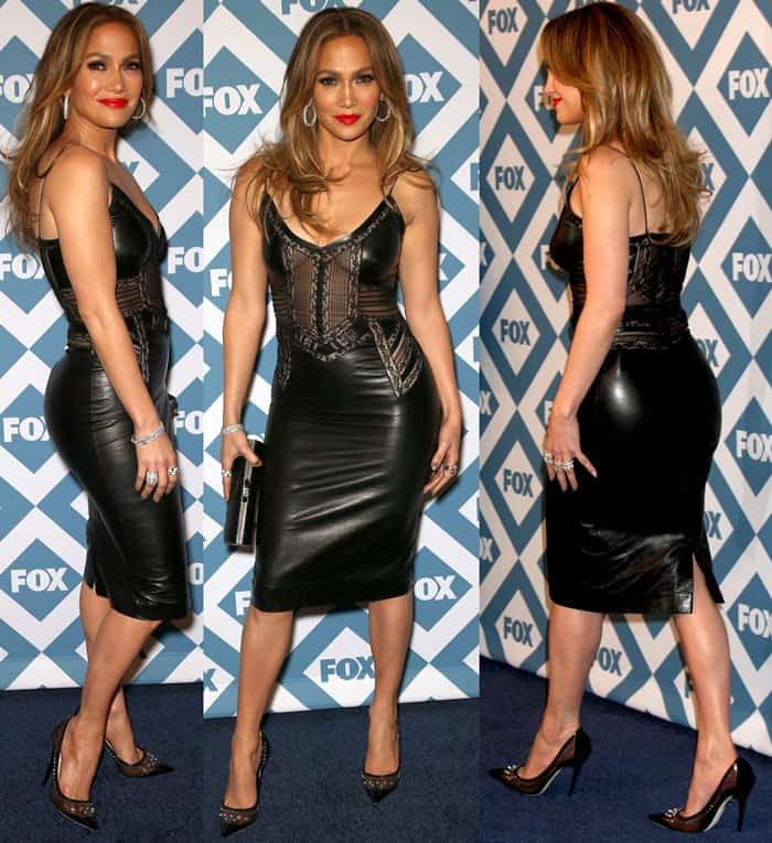 Jennifer Lopez wore an Ermanno Scervino leather dress featuring sheer lace inserts and fitted pencil skirt