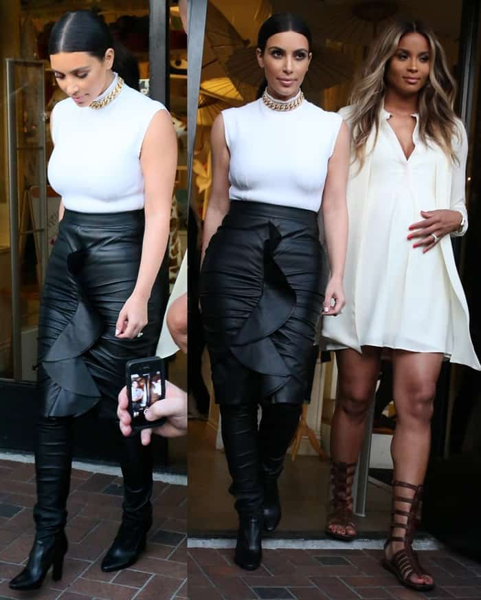 Kim Kardashian, pictured with Ciara Harris, seen filming a segment for the show Keeping Up with the Kardashians at the Bel Bambini baby store in West Hollywood, California, on February 12, 2014