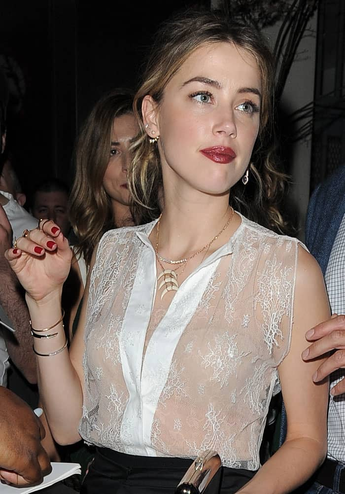 Amber Heard looked nice but her Tome Spring 2015 outfit will make you do a double take